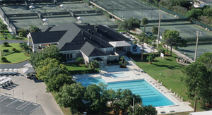Aerial view of Bardmoor Golf & Tennis Club pool and clubhouse with tennis courts in the backround
