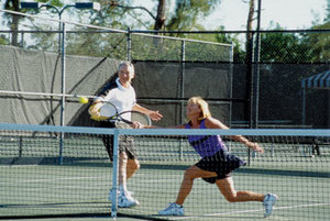 A couple plays tennis